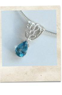 Blue topaz and sterling silver pendant necklace - click for details