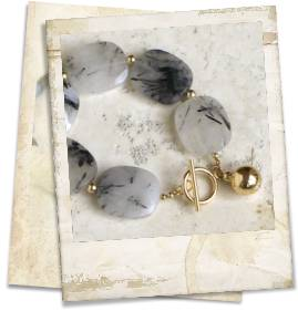 Tourmalinated quartz and 14kt rolled gold bracelet - click for details